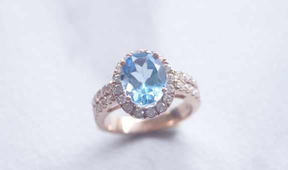 Crystals Jewelry -  Oval Cut of Blue Stone and Diamond Halo Bridal Set in Rose Gold