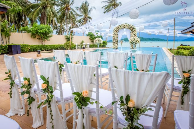 A beautiful private villa wedding featuring stunning flowers on an overwater stage. by Unique Wedding and Events - 004
