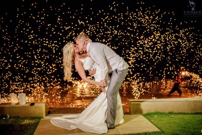 A beautiful private villa wedding featuring stunning flowers on an overwater stage. by Unique Wedding and Events - 029