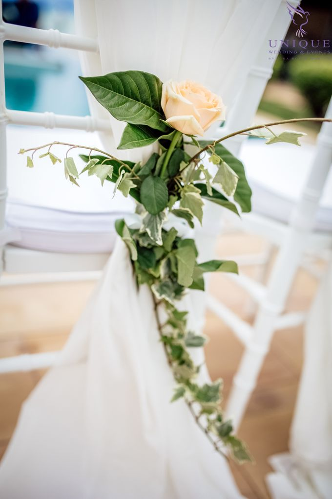 A beautiful private villa wedding featuring stunning flowers on an overwater stage. by Unique Wedding and Events - 007