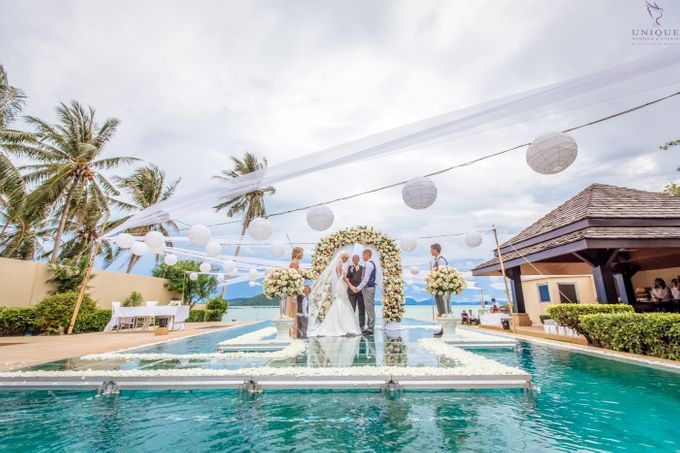 A beautiful private villa wedding featuring stunning flowers on an overwater stage. by Unique Wedding and Events - 012