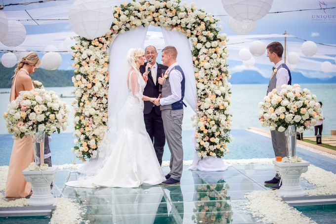 A beautiful private villa wedding featuring stunning flowers on an overwater stage. by Unique Wedding and Events - 014