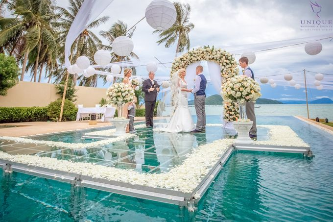 A beautiful private villa wedding featuring stunning flowers on an overwater stage. by Unique Wedding and Events - 015