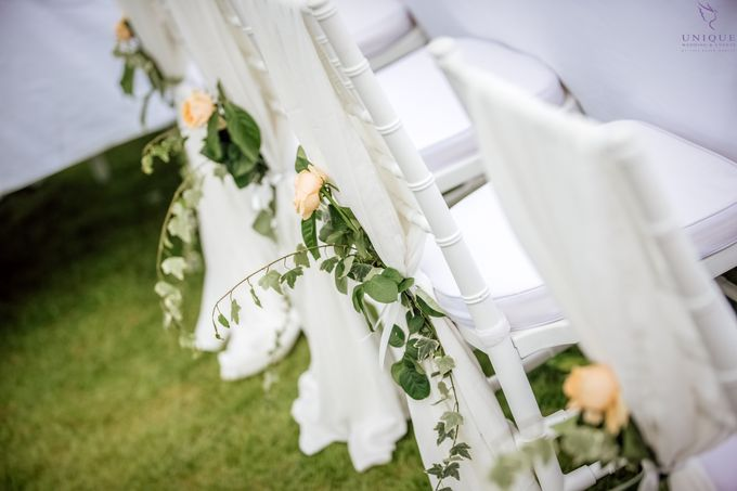 A beautiful private villa wedding featuring stunning flowers on an overwater stage. by Unique Wedding and Events - 023