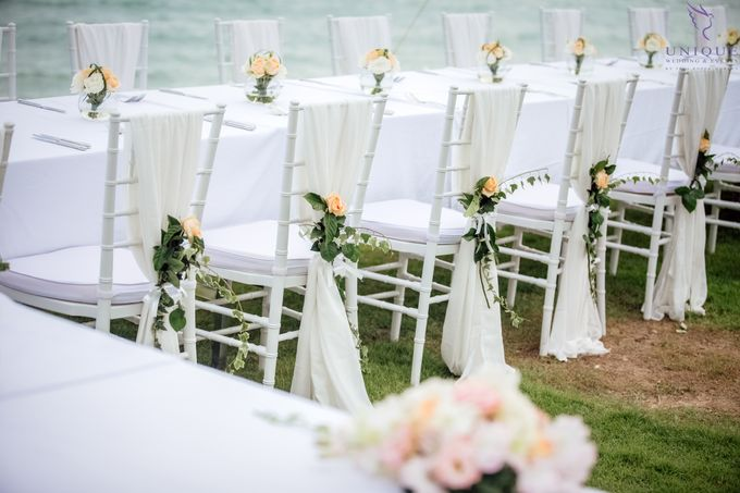 A beautiful private villa wedding featuring stunning flowers on an overwater stage. by Unique Wedding and Events - 024