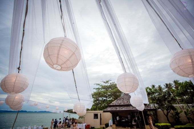 A beautiful private villa wedding featuring stunning flowers on an overwater stage. by Unique Wedding and Events - 025