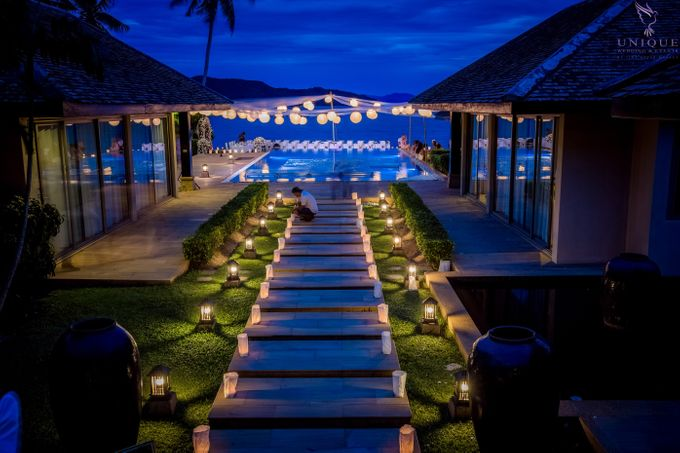 A beautiful private villa wedding featuring stunning flowers on an overwater stage. by Unique Wedding and Events - 027