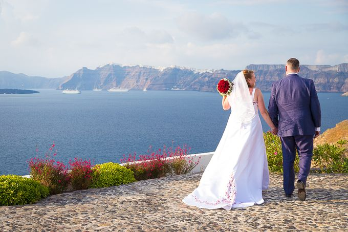 Beach wedding in Santorini by Red Knot Weddings & Events - 008