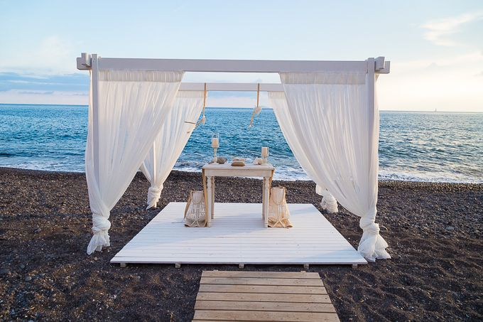 Beach wedding in Santorini by Red Knot Weddings & Events - 011