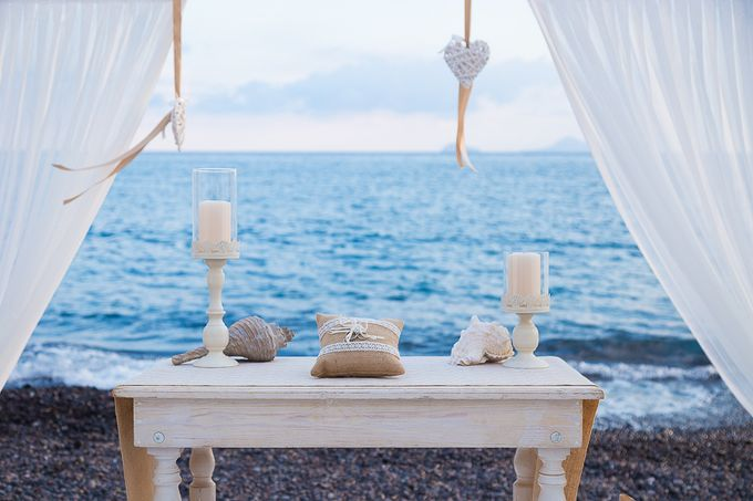 Beach wedding in Santorini by Red Knot Weddings & Events - 012