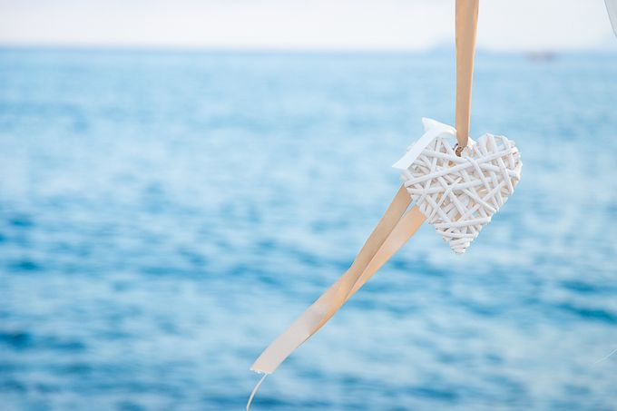 Beach wedding in Santorini by Red Knot Weddings & Events - 014