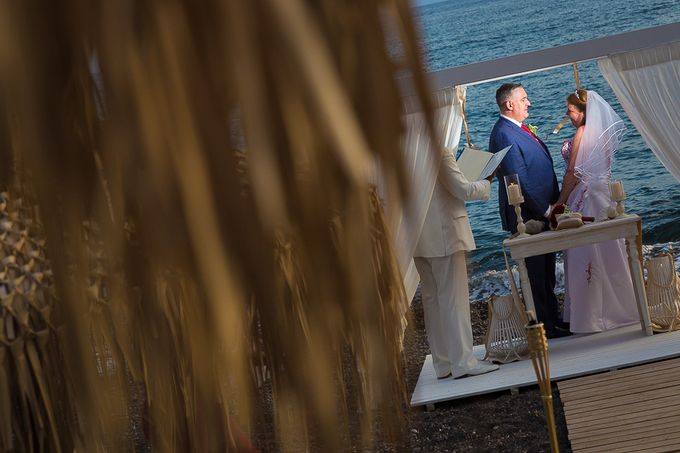 Beach wedding in Santorini by Red Knot Weddings & Events - 020