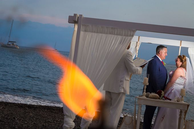 Beach wedding in Santorini by Red Knot Weddings & Events - 021