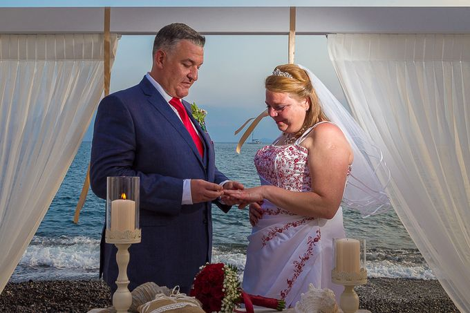 Beach wedding in Santorini by Red Knot Weddings & Events - 022