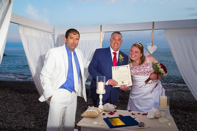 Beach wedding in Santorini by Red Knot Weddings & Events - 026