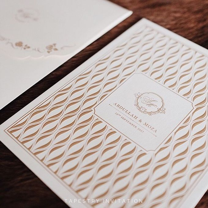 A simple yet elegant gold on creme invitation for our client in a far away country by Tapestry Invitation - 002