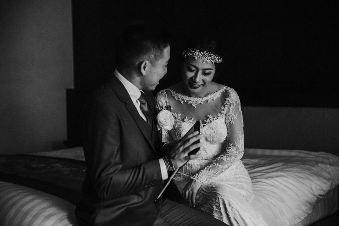 Christine & Dirga - Puri Santrian Wedding by ILUMINEN - 030