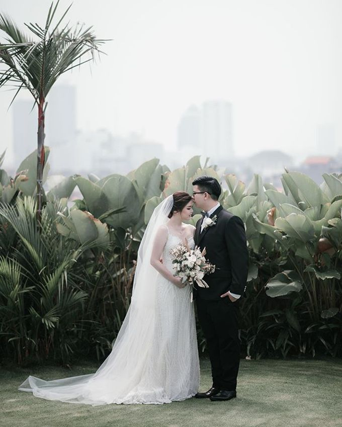 Prawira & Feli Wedding by unravel photograph - 004