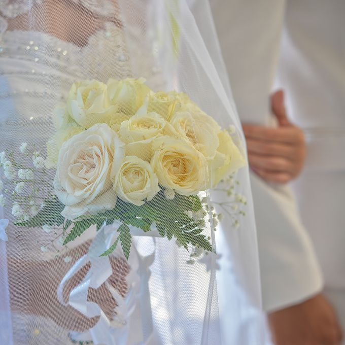 Courtesy of Wedding Day Ningsih and Aji by RWP Photocinema - 002