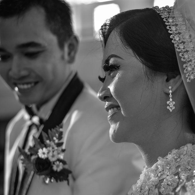 Courtesy of Wedding Day Ningsih and Aji by RWP Photocinema - 006