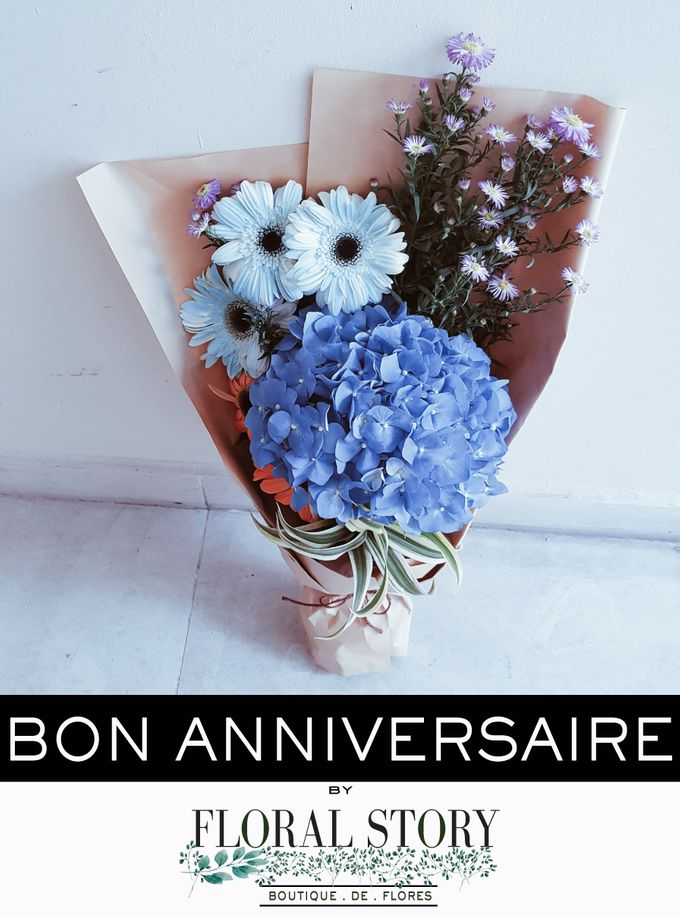 Bon Anniversaire With Limited Edition Dyed Light Blue Daisies By