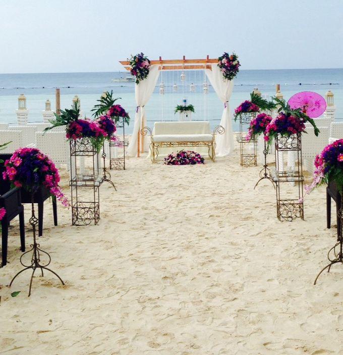 Beach Wedding by The Bellevue Resort - 001