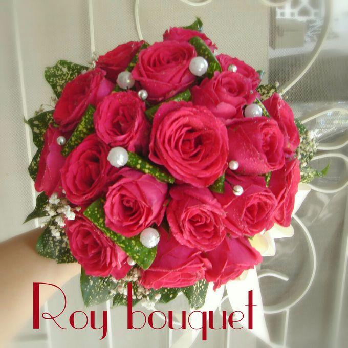 Simple Fresh flowers bridal bouquets by Roy Bouquet | Bridestory.com