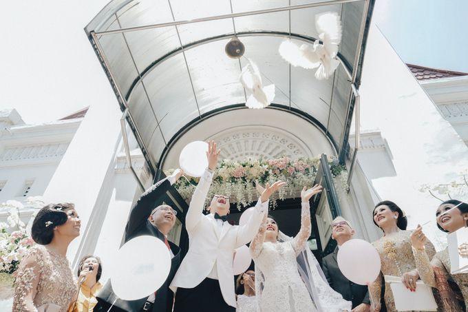 Togi & Jesicca - Holy Matrimony & Batak Ceremony by JAYSU Weddings by Jacky Suharto - 037