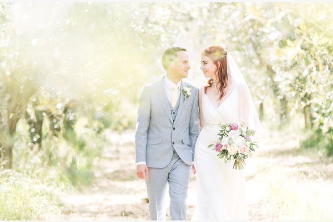 Romantic wedding with a symbolic ceremony in Lucca through the olives of the Tuscan countryside by PURE wedding photography - 007