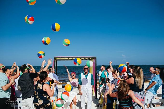 This was an amazing colorful wedding, starting from the bride, venue, and celebration by Ivan Luckie Photography - 010