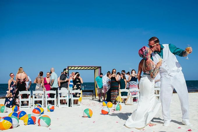 This was an amazing colorful wedding, starting from the bride, venue, and celebration by Ivan Luckie Photography - 011