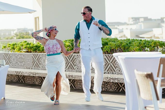 This was an amazing colorful wedding, starting from the bride, venue, and celebration by Ivan Luckie Photography - 013