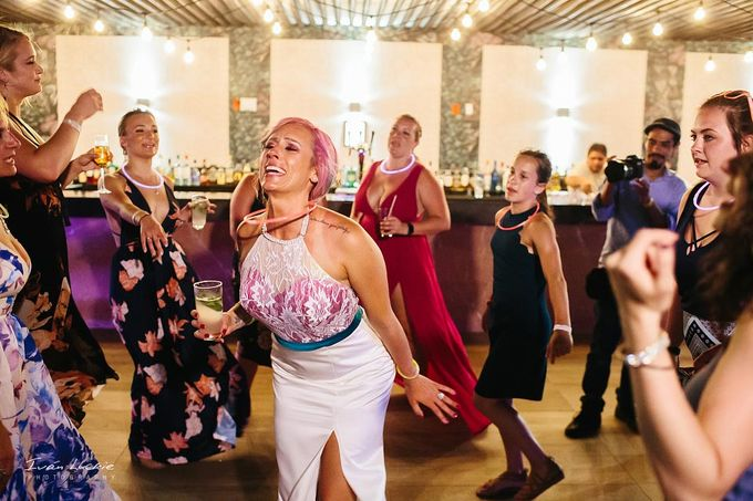This was an amazing colorful wedding, starting from the bride, venue, and celebration by Ivan Luckie Photography - 019