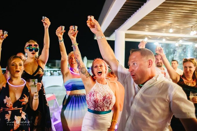 This was an amazing colorful wedding, starting from the bride, venue, and celebration by Ivan Luckie Photography - 022