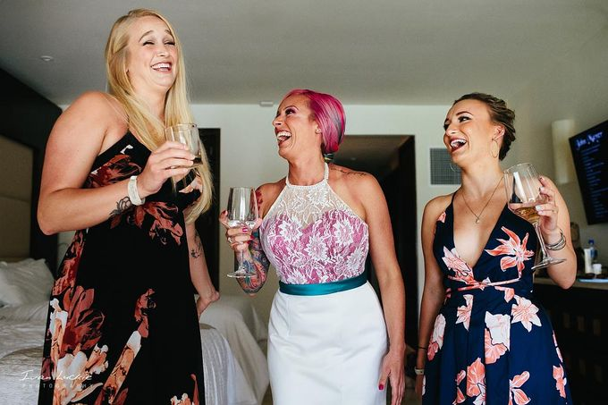 This was an amazing colorful wedding, starting from the bride, venue, and celebration by Ivan Luckie Photography - 005