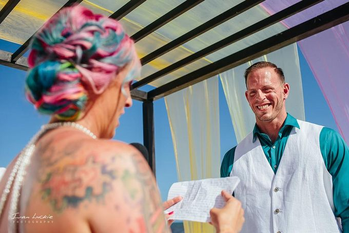 This was an amazing colorful wedding, starting from the bride, venue, and celebration by Ivan Luckie Photography - 009