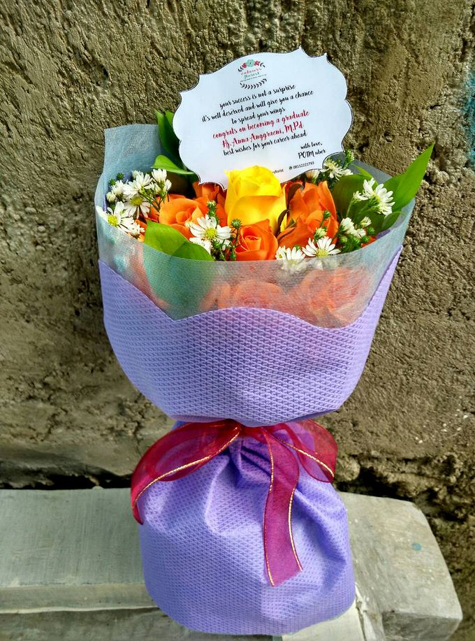 Orange Hand bouquet by Colours Florist - 001