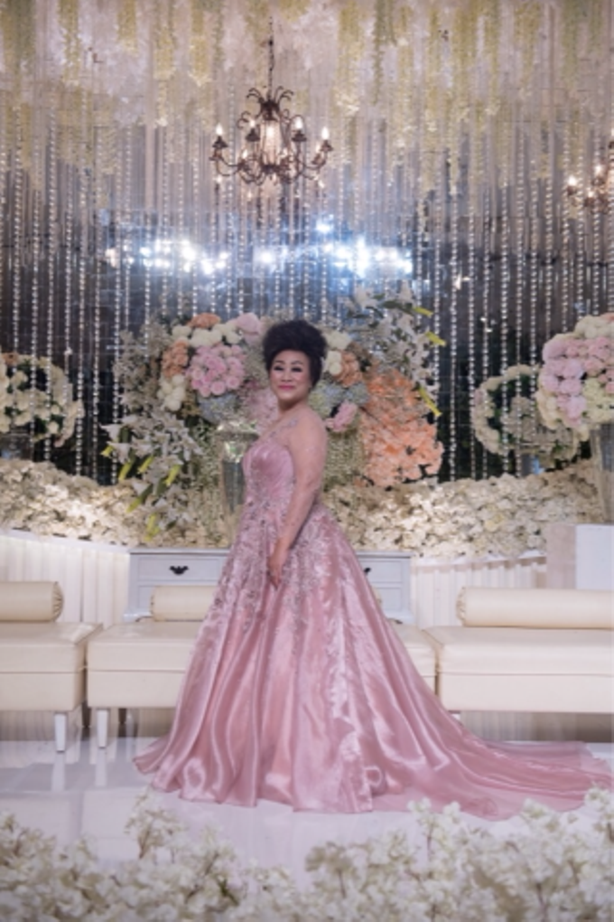 Groom and bride family-pastel colors gowns by Boenga Bridal Couture - 001