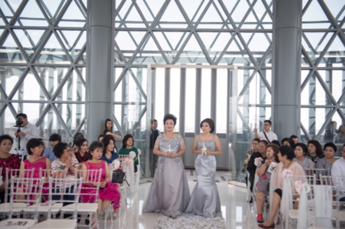 Groom and bride family-pastel colors gowns by Boenga Bridal Couture - 016