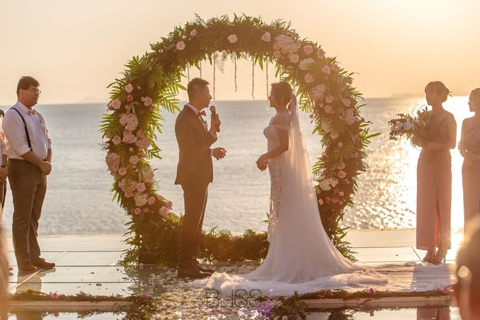 Romantic wedding ceremony on the over water with transparency stage at conrad koh samui by BLISS Events & Weddings Thailand - 009