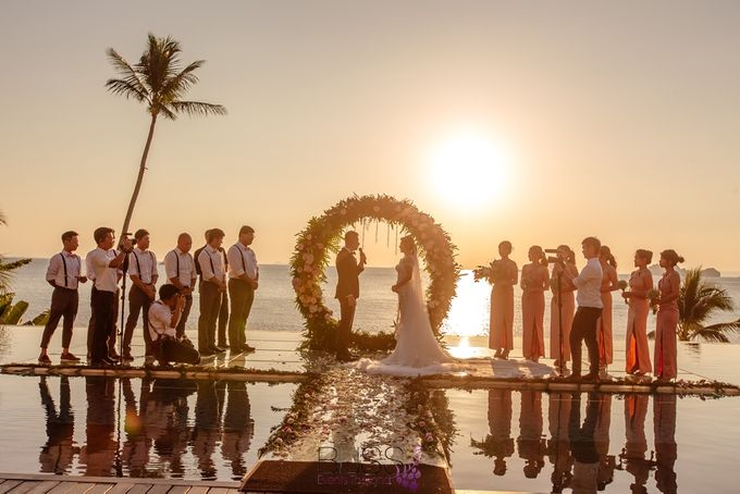 Romantic wedding ceremony on the over water with transparency stage at conrad koh samui by BLISS Events & Weddings Thailand - 010