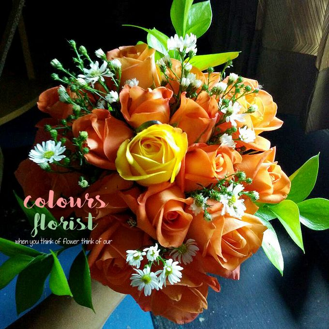 Orange Hand bouquet by Colours Florist - 002