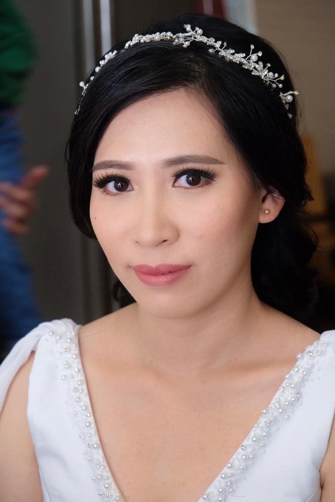 Wedding day makeup for Ms. Yani by Erliana Lim Makeup Artist - 002