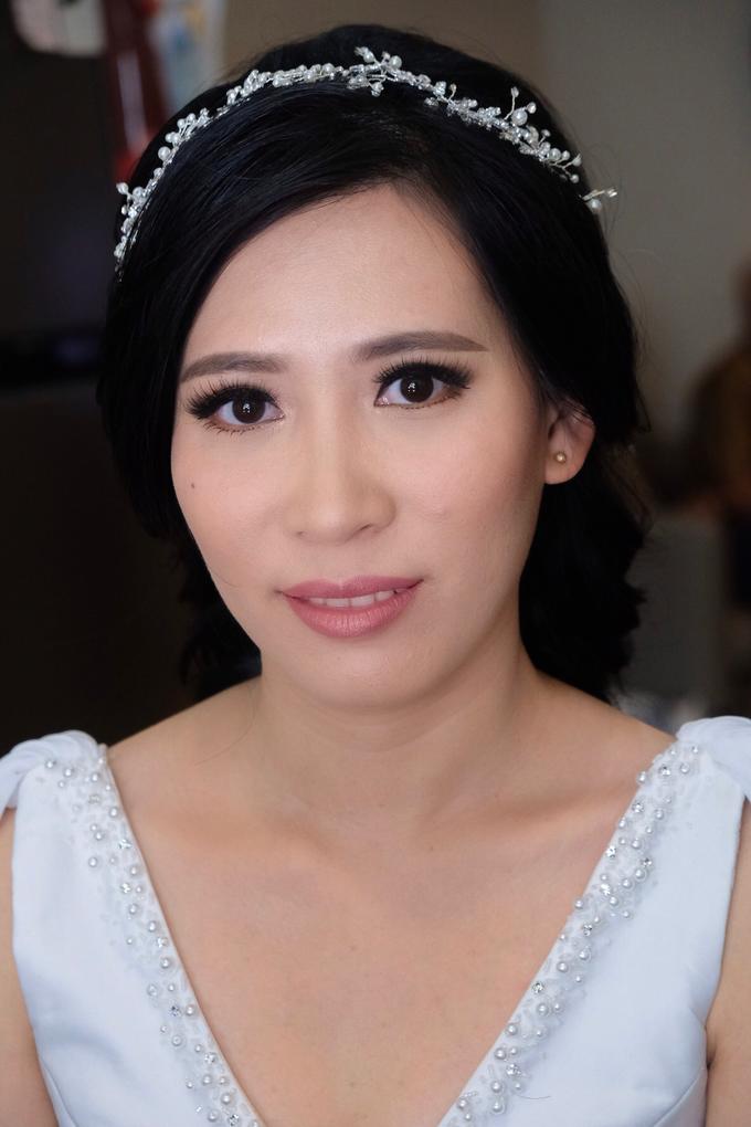 Wedding day makeup for Ms. Yani by Erliana Lim Makeup Artist - 001