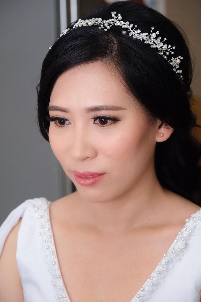 Wedding day makeup for Ms. Yani by Erliana Lim Makeup Artist - 003