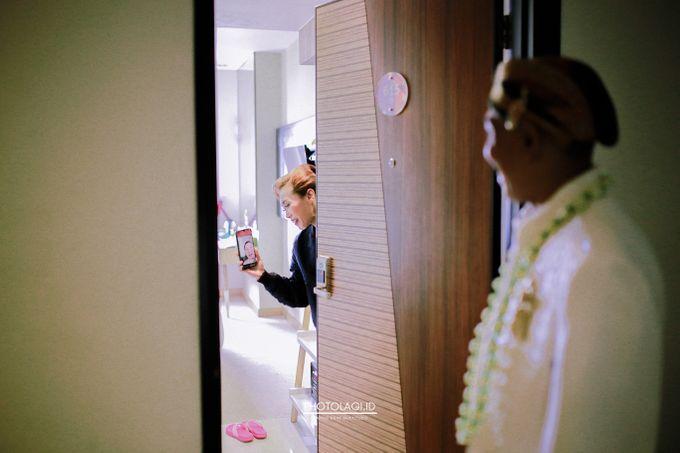 Holy Matrimony / Pemberkatan for Yinta + Adi by Photolagi.id - 008
