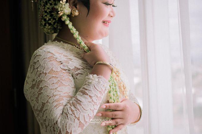 Holy Matrimony / Pemberkatan for Yinta + Adi by Photolagi.id - 009