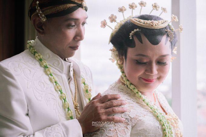Holy Matrimony / Pemberkatan for Yinta + Adi by Photolagi.id - 012