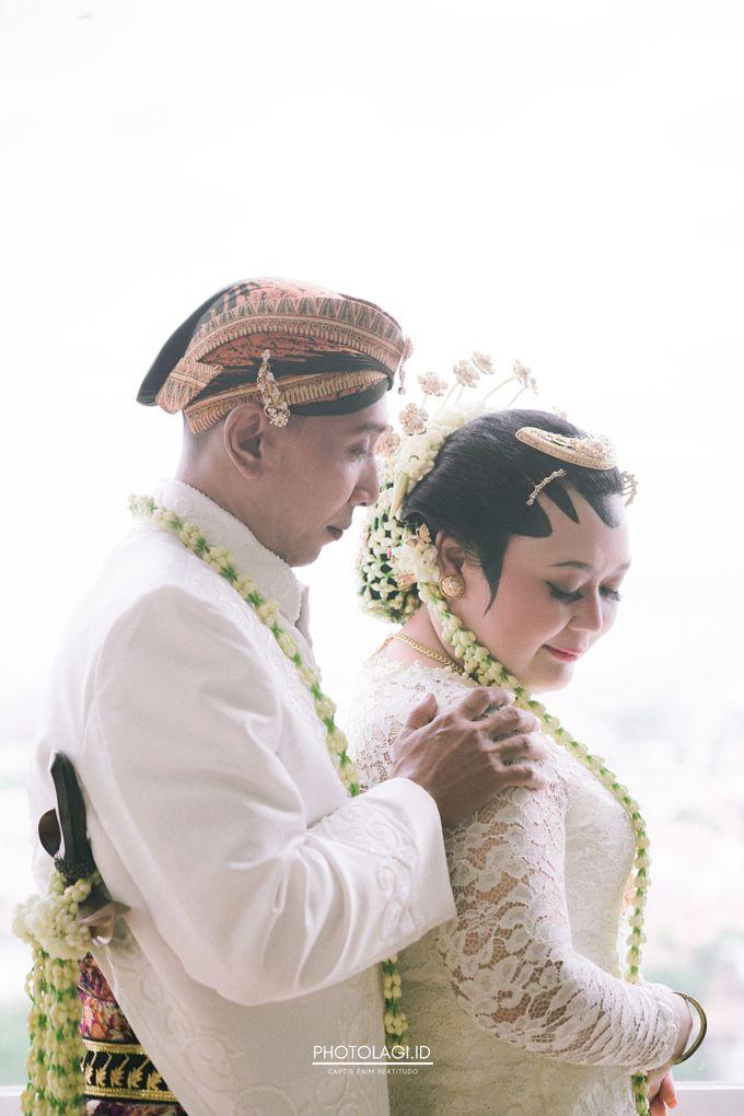 Holy Matrimony / Pemberkatan for Yinta + Adi by Photolagi.id - 010