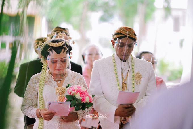 Holy Matrimony / Pemberkatan for Yinta + Adi by Photolagi.id - 013
